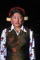 Tibetan woman in head gear, tagong, Kham, Tibet, 2005