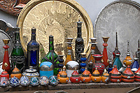 Tripoli, Libya - Antique Glassware, Copper Market (Suq al-Ghizdir), Tripoli Medina (Old City).  Bottles, Metal Trays.