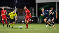 LAKE BUENA VISTA, FL - JULY 26: Nick DeLeon of Toronto FC dribbles away from Alexander Ring of New York City FC and James Sands of New York City FC during a game between New York City FC and Toronto FC at ESPN Wide World of Sports on July 26, 2020 in Lake Buena Vista, Florida.
