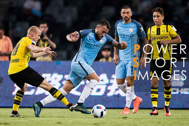 Manchester City defender Nicolas Otamendi (c) fights for the ball with Borussia Dortmund midfielder Sebastian Rode (l) during the match against Borussia Dortmund at the 2016 International Champions Cup China match at the Shenzhen Stadium on 28 July 2016 in Shenzhen, China. Photo by Victor Fraile / Power Sport Images
