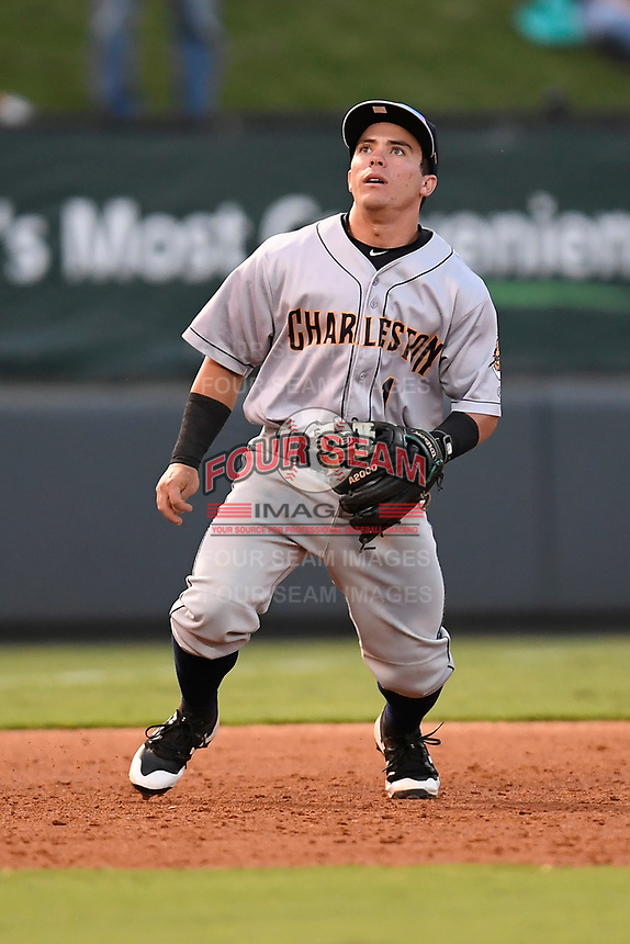 Third baseman Jose Carrera (1) of the Charleston RiverDogs plays defense in Game 2 of the South Atlantic League Southern Division Playoff against the Greenville Drive on Friday, September 8, 2017, at Fluor Field at the West End in Greenville, South Carolina. Charleston won, 2-1, and the series is tied at one game each. (Tom Priddy/Four Seam Images)