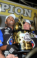 Nov. 11, 2012; Pomona, CA, USA: NHRA top fuel dragster driver Antron Brown (left) celebrates with crew chief Mark Oswald after winning the 2012 championship during the Auto Club Finals at at Auto Club Raceway at Pomona. Mandatory Credit: Mark J. Rebilas-