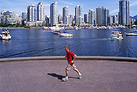 Vancouver, BC, British Columbia, Canada - City Skyline at False Creek and Yaletown, Man jogging on Seawall, Aquabus Ferry Public Transportation, Summer