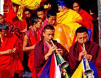 monks playing <br /> trumpet, Bhutan Shungdrei ceremony at the Paro Teschu festival, Paro Dzong Monastery, Paro Valley, Bhutan