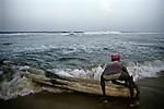 A fisherman tries to go into the sea with his Catamaran at Kovalam beach, Trivandrum, Kerala, India.