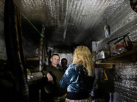 Natalia Voronkova, a volunteer who offers support and basic first aid training for Ukrainian government forces fighting Russian-backed separatists in the east of the country, speaks with a soldier inside an underground bunker where his small group sleep and take cover during bombardments. The group manage a check point close to the frontline and as Natalia passes by she uses the opportunity to get a unfiltered sense of the reality and challenges the soldiers face on the ground; impressions she uses as a special advisor to the Ministry of Defence.