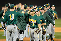 Siena Saints outfielder Andres Ortiz #3 celebrates with teammates after a game against the Central Florida Knights at Jay Bergman Field on February 16, 2013 in Orlando, Florida.  Siena defeated UCF 7-4.  (Mike Janes/Four Seam Images)