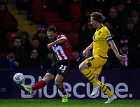 Lincoln City's Neal Eardley vies for possession with Milton Keynes Dons' Dean Lewington<br /> <br /> Photographer Andrew Vaughan/CameraSport<br /> <br /> The EFL Sky Bet League One - Lincoln City v Milton Keynes Dons - Tuesday 11th February 2020 - LNER Stadium - Lincoln<br /> <br /> World Copyright © 2020 CameraSport. All rights reserved. 43 Linden Ave. Countesthorpe. Leicester. England. LE8 5PG - Tel: +44 (0) 116 277 4147 - admin@camerasport.com - www.camerasport.com