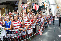 New York, New York - Friday July 10, 2015: Fans line the streets as the USWNT participate in a ticker tape parade in their honor up the Canyon of Hero's.