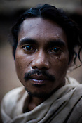 Mukuna Sikaka poses for a portrait in Salpojola village in Niyamgiri hills. He is one of the many people who will get displaced if the aluminium company Vedanta carries on with its plans of mining of Bauxide in Niyamgiri hills in Rayagara district of Orissa in India.