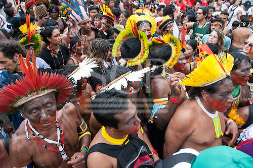 Indigenous people demonstrate at a march by indigenous people, the Landless People's Movement (MST) and other civil society groups in front of the Riocentro United Nations conference. The demonstrators are kept out of earshot and invisible to the UN conference. United Nations Conference on Sustainable Development (Rio+20), Rio de Janeiro, Brazil, 20th June 2012. Photo © Patrick Cunningham.