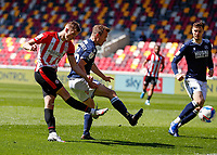 17th April 2021; Brentford Community Stadium, London, England; English Football League Championship Football, Brentford FC versus Millwall; Marcus Forss of Brentford takes a shot past Alex Pearce of Millwall