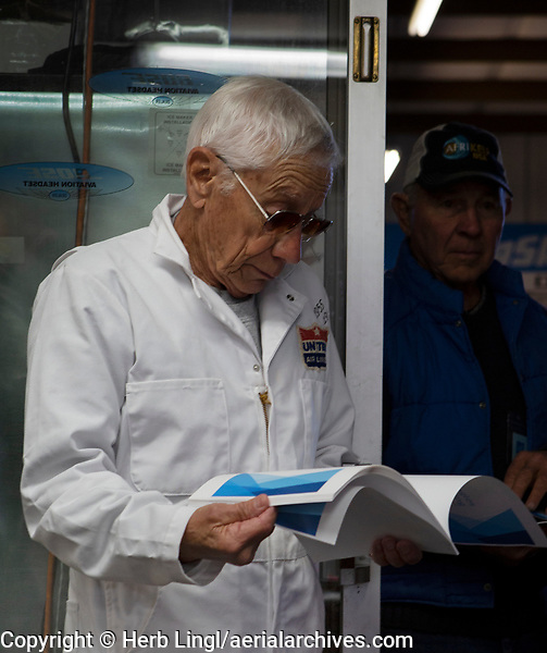 Pilot and retired United Airlines aircraft mechanic Lee Beery reviews the pilot briefing at a Young Eagles Rally, Lampson Field (102), Lakeport, Lake County, California.  Lee is wearing the same coveralls that he wore at United Airlines in 1955.