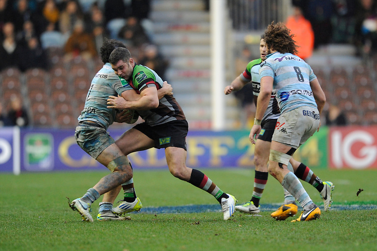 Nick Easter of Harlequins is tackled by Antoine Battut of Racing Metro 92 as Camille Gerondeau of Racing Metro 92 supports during the Heineken Cup match between Harlequins and Racing Metro 92 at the Twickenham Stoop on Sunday 15th December 2013 (Photo by Rob Munro)