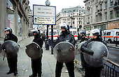Police with riot-shields and helmets cordon off Oxford Circus during May Day anti-capitalist protests in central London.