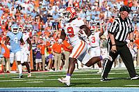 CHAPEL HILL, NC - SEPTEMBER 28: Travis Etienne #9 of Clemson University scores a touchdown during a game between Clemson University and University of North Carolina at Kenan Memorial Stadium on September 28, 2019 in Chapel Hill, North Carolina.
