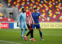 20th March 2021; Brentford Community Stadium, London, England; English Football League Championship Football, Brentford FC versus Nottingham Forest; Pontus Jansson of Brentford looks on with Tobias Figueiredo and Goalkeeper Brice Samba of Nottingham Forest