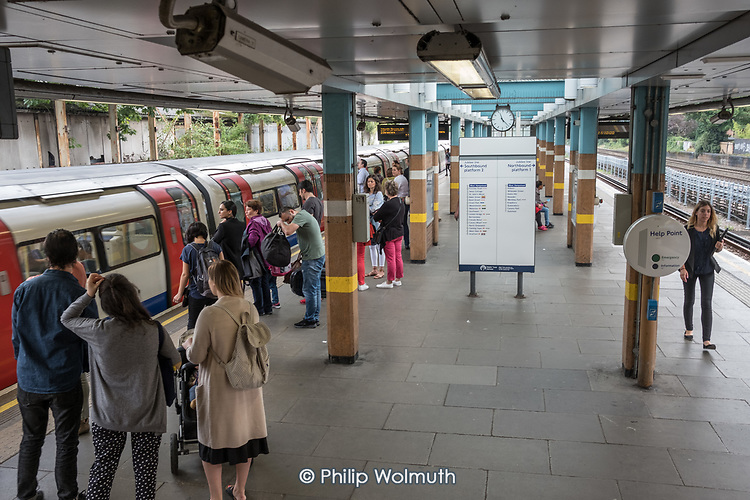 Passengers wait to board a Jubilee line train at West Hampstead underground station.