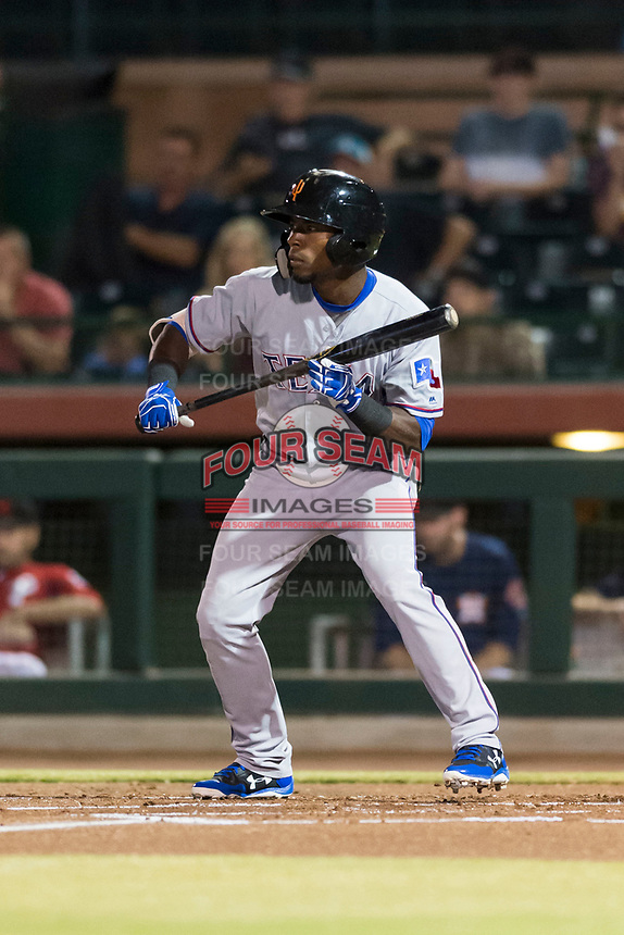 Surprise Saguaros left fielder Julio Pablo Martinez (40), of the Texas Rangers organization, shows bunt during an Arizona Fall League game against the Scottsdale Scorpions at Scottsdale Stadium on October 15, 2018 in Scottsdale, Arizona. Surprise defeated Scottsdale 2-0. (Zachary Lucy/Four Seam Images)