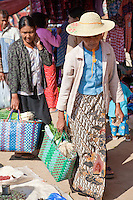 "Myanmar, Burma.  Burmese Women Shopping in the ""Five-Day"" Market, Inle Lake, Shan State."