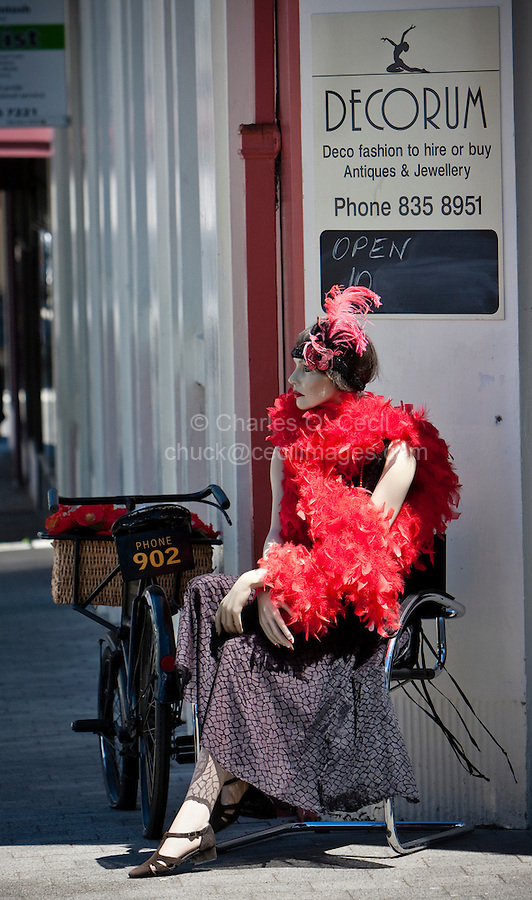 Napier, New Zealand.  Store Mannequin in front of Clothing Store.