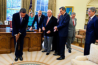 President Barack Obama practices with a golf club after the signing ceremony for H.R. 1243, the Arnold Palmer Congressional Gold Medal Act, in the Oval Office, Sept. 30, 2009. (Official White House photo by Samantha Appleton)<br /> <br /> This official White House photograph is being made available only for publication by news organizations and/or for personal use printing by the subject(s) of the photograph. The photograph may not be manipulated in any way and may not be used in commercial or political materials, advertisements, emails, products, promotions that in any way suggests approval or endorsement of the President, the First Family, or the White House.