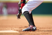Michael De Leon (1) of the Hickory Crawdads takes his lead off of first base against the Savannah Sand Gnats at L.P. Frans Stadium on June 14, 2015 in Hickory, North Carolina.  The Crawdads defeated the Sand Gnats 8-1.  (Brian Westerholt/Four Seam Images)