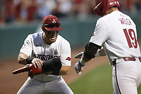 Arkansas Zack Gregory (3) fits a glove on catcher Charlie Welch (19), Monday, June 7, 2021 in the eighth inning of the NCAA Fayetteville Regional at Baum-Walker Stadium in Fayetteville. Check out nwaonline.com/210608Daily/ for today's photo gallery. <br /> (NWA Democrat-Gazette/Charlie Kaijo)