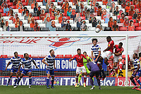 Chuks Aneke of Charlton heads the ball towards the Reading goal as Charlton's Pop Up fans look on during Charlton Athletic vs Reading, Sky Bet EFL Championship Football at The Valley on 11th July 2020