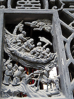 Detail of a door sculpture.  Yu Gardens, a peaceful place to escape the bustle of Shanghai.  Full of visitors, still very calming.  Details in the buildings, doors and stone sculptures.  Helps get your Ying and Yang in balance.