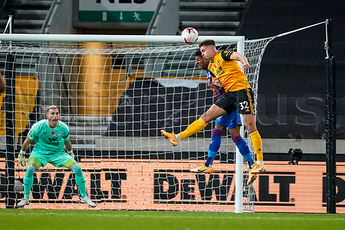 30th October 2020; Molineux Stadium, Wolverhampton, West Midlands, England; English Premier League Football, Wolverhampton Wanderers versus Crystal Palace; Leander Dendoncker of Wolverhampton Wanderers competes hard in the air to get a headed chance on target