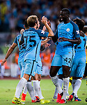 SHENZHEN - JULY 28: Manchester City midfielder Yaya toure (r) celebrates the score with Manchester City midfielder Aleix Garcia during the match between Borussia Dortmund vs Manchester City FC at the 2016 International Champions Cup China match at the Shenzhen Stadium on 28 July 2016 in Shenzhen, China. (Photo by Power Sport Images/Getty Images)