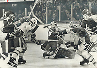 1970 FILE PHOTO - ARCHIVES -<br /> <br /> Under Attack: Leafs goalie Mike Palmateer is surrounded by flailing sticks and falling bodies during Stanley Cup semi-final game at Montreal. On this play; Palmateer managed to hold off Habs Steve Shutt (22) and Guy Lafleur (10); while Leaf Trevor Johansen (4) searches for puck. Habs dumped Leafs; 3-2; to take 2-0 series lead; which switches to Gardens for next games; Saturday and Tuesday. Leafs say they'll do better.<br /> <br /> Bezant, Graham<br /> Picture, 1978, <br /> <br /> 1978<br /> <br /> PHOTO : Graham Bezant - Toronto Star Archives - AQP