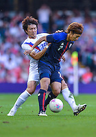 August 10, 2012..South Korea's Park Jong-woo and Japan's Yuki Otsu in action during bronze medal match at the Millennium Stadium on day fourteen in Cardiff, England. Korea defeat Japan 2-0 to win Olympic bronze medal in men's soccer.