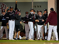 Riverview Rams celebrate in the dugout during a game against the Sarasota Sailors on February 19, 2021 at Rams Baseball Complex in Sarasota, Florida. (Mike Janes/Four Seam Images)