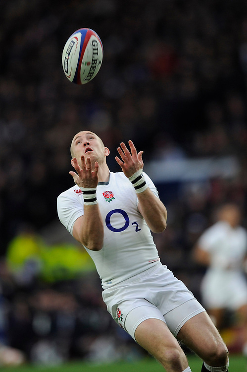 Mike Brown of England keeps a close eye on a high ball