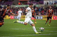 Fernando Llorente of Swansea City crosses the ball into the Hull box during the Premier League match between Swansea City and Hull City at the Liberty Stadium, Swansea on Saturday August 20th 2016