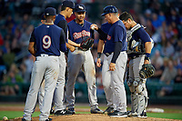 Scranton/Wilkes-Barre RailRiders manager Al Pedrique (13) hands the ball to relief pitcher Giovanny Gallegos (26) during a pitching change as Miguel Andujar (9), Jonathan Diaz (hidden), Starlin Castro (14), Ji-Man Choi (hidden), and Eddy Rodriguez (45) look on during the first game of a doubleheader against the Rochester Red Wings on August 23, 2017 at Frontier Field in Rochester, New York.  Rochester defeated Scranton 5-4 in a game that was originally started on August 22nd but was was postponed due to inclement weather.  (Mike Janes/Four Seam Images)