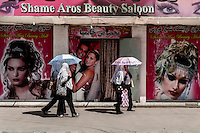 Afghan girls passing  from a beauty salon in Kabul /Felix Features