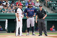 Manager Kaneoka Texeira (50) of the Rome Braves, center, meets with manager Iggy Suarez (2) of the Greenville Drive and umpires Dylan Bradley and Joe Belangia before a game on Tuesday, August 3, 2021, at Fluor Field at the West End in Greenville, South Carolina. (Tom Priddy/Four Seam Images)