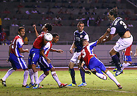 SAN JOSE, COSTA RICA - September 06, 2013: Omar Gonzalez (3) of the USA MNT heads the ball at Yeltsin Tejeda (17) of the Costa Rica MNT during a 2014 World Cup qualifying match at the National Stadium in San Jose on September 6. USA lost 3-1.