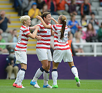 Newcastle, England - Friday, August 3, 2012: The USA women defeated New Zealand 2-0 in the quarterfinal round of the 2012 Olympics at St. James Park. Abby Wambach celebrates her goal with Megan Rapinoe and Alex Morgan.