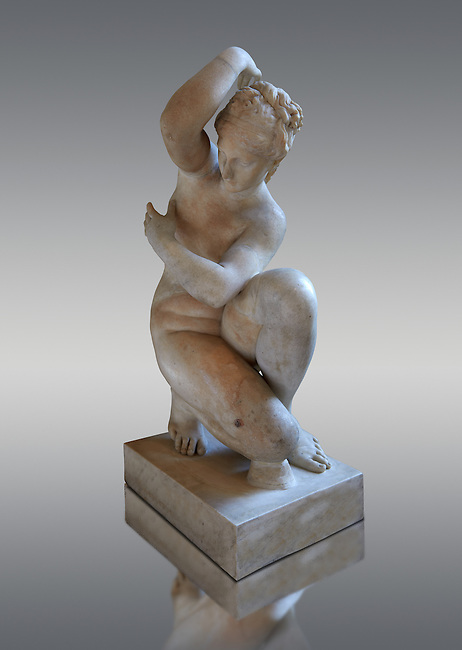 Crouching Aphrodite (Venus). 2nd Century Imperial Roman Marble Statue from Italy. Louvre Museum, Paris. Cat No MR 371 <br /> This sculpture  is a variation on the Classic Hellanistic 3rd to Ist century BC style of Aphrodite crouching to bathe. Aphrodite crouches with her right knee close to the ground, turns her head to the right and, in most versions, reaches her right arm over to her left shoulder to cover her breasts. The sculpture here changes the pattern by raising the right arm to the neck, rather than making her arm cross her chest, this flattens the composition.