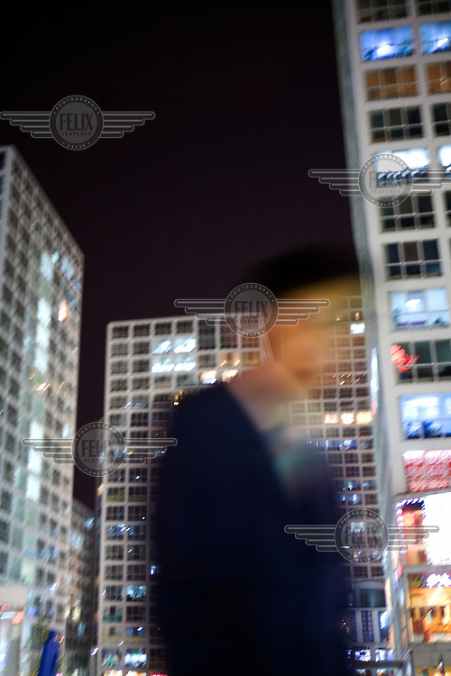 An office worker heads home from Beijing's Central Business District.