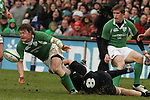Dublin Ireland, Irelands no 13 Brian O'Droscoll being taken down by Scotland No 8 Simon Taylor during the RBS 6 Nations Match Ireland V Scotland at Lansdowne Road Dublin Ireland. 11/3/06.Photo AFP/NEWSFILE/FRAN CAFFREY..(Photo credit should read AFP PHOTO/FRAN CAFFREY/NEWSFILE)...This Picture has been sent you under the condtions enclosed by:.Newsfile Ltd..the Studio,.Millmount Abbey,.Drogheda,.Co Meath..Ireland..Tel: +353(0)41-9871240.Fax: +353(0)41-9871260.GSM: +353(0)86-2500958.email: pictures@newsfile.ie.www.newsfile.ie.FTP: 193.120.102.198..This picture is from Fran Caffrey@newsfile.ie
