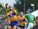 Peter Duggan of Clare in action against Mike Casey of Limerick during their Munster championship game in Ennis. Photograph by John Kelly.