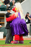 Home plate umpire Thomas Newsom dances with Winston-Salem Dash mascot Bolt between innings of the Carolina League game between the Frederick Keys and the Winston-Salem Dash at BB&T Ballpark on August 5, 2011 in Winston-Salem, North Carolina.  The Dash defeated the Keys 10-0.   Brian Westerholt / Four Seam Images