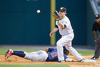 Andy Wilkins (17) of the Charlotte Knights waits for a throw as Tyson Gillies (13) of the Lehigh Valley IronPigs dives back into first base at BB&T Ballpark on May 8, 2014 in Charlotte, North Carolina.  The IronPigs defeated the Knights 8-6.  (Brian Westerholt/Four Seam Images)