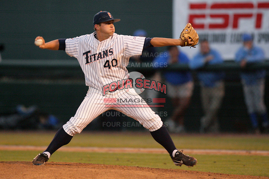Kyle Mertins of the Cal.St. Fullerton Titans during game against the UCLA Bruins at Jackie Robinson Stadium in Los Angeles,California on June 12, 2010. Photo by Larry Goren/Four Seam Images