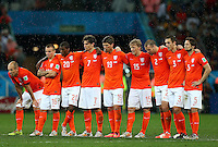 The Netherlands team show a look of dejection during the penalty shootout